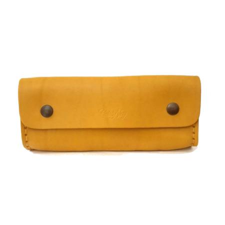 Tousse jaune en cuir